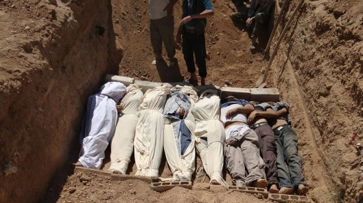 This image provided by by Shaam News Network on Thursday, Aug. 22, 2013, purports to show several bodies being buried in a suburb of Damascus, Syria during a funeral on Wednesday, Aug. 21, 2013, following allegations of a chemical weapons attack that reportedly killed 355 people. (AP Photo/Shaam News Network)