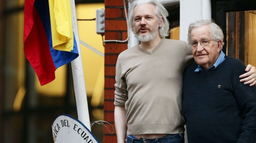 Julian Assange of WikiLeaks makes a balcony appearance with Noam Chomsky at the Ecuadorian Embassy in London - (AP Photo/Yui Mok, PA Wire)