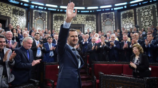 Syria's president Bashar al-Assad waves to parliament members in Damascus, Syria.