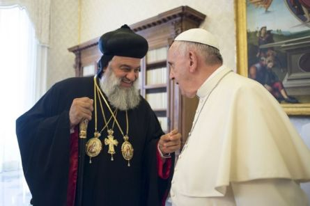 Pope Francis (R) talks with Ignatius Aphrem II, Syriac Orthodox Patriarch of Antioch, during a meeting at the Vatican, on June 19, 2015.