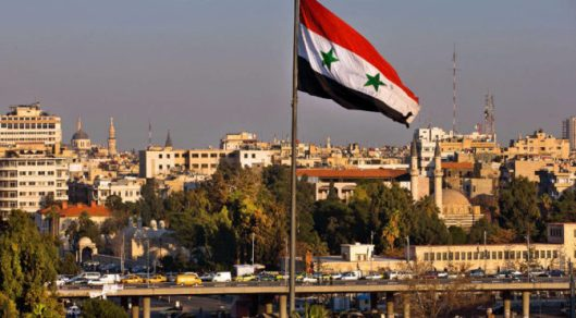 syria-flag-skying-672x372