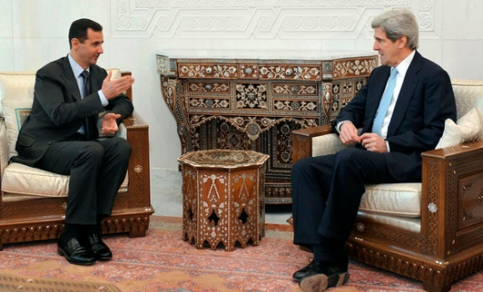 Syria's President Bashar al-Assad (L) meets Senator John Kerry, chairman of the U.S. Senate Foreign Relations Committee, in Damascus February 21, 2009.  REUTERS/Sana (SYRIA) - RTXBW2Q