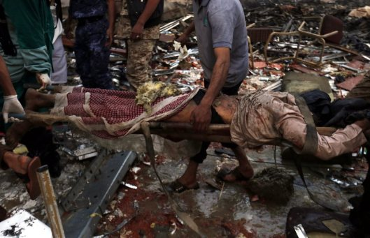 epa05576816 Yemenis carry the body of a victim of Saudi-led airstrikes that hit a funeral ceremony in Sana¿a, Yemen, 08 October 2016. According to reports, at least 82 Yemenis were killed and more than 534 injured when Saudi-led airstrikes hit a funeral hall filled with mourners in the Yemeni capital Sana¿a. EPA/YAHYA ARHAB